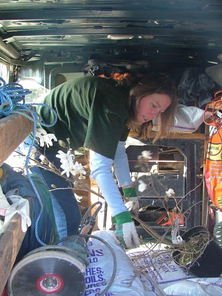 Carol looking in the back of the van