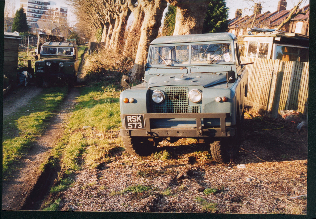 landrovers parked by R2